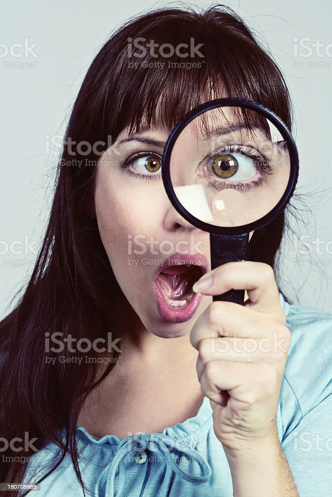 Woman with Magnifying Glass royalty-free stock photo