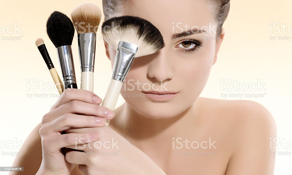 woman with makeup brushes royalty-free stock photo