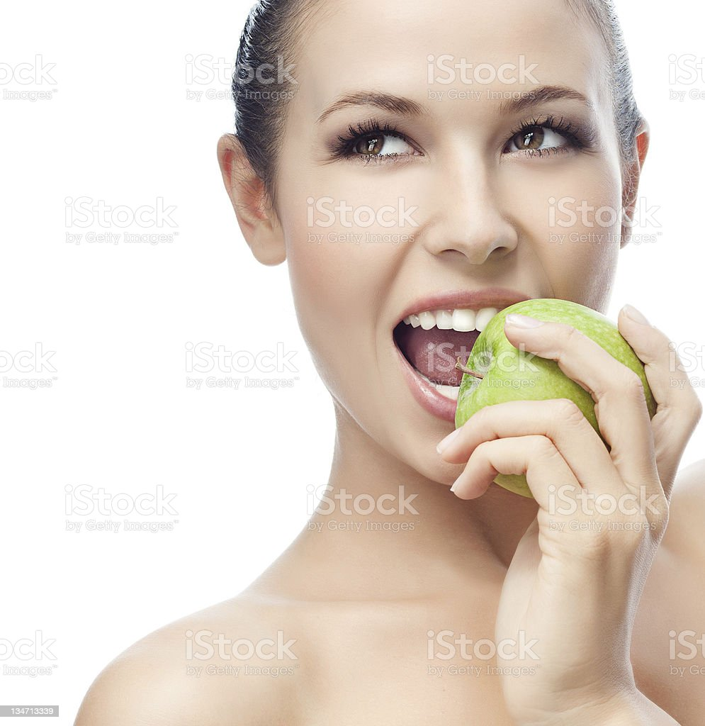 Woman with makeup on eating a green apple royalty-free stock photo