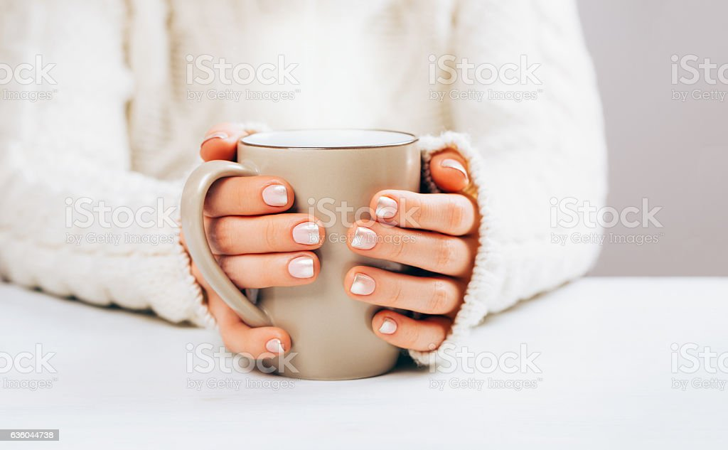 Woman with manicure and cup. stock photo