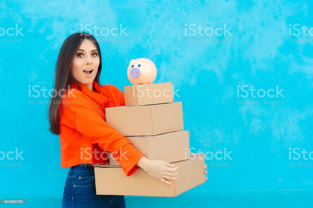 Woman with Many Cardboard Boxes Packages Received from Delivery Service stock photo
