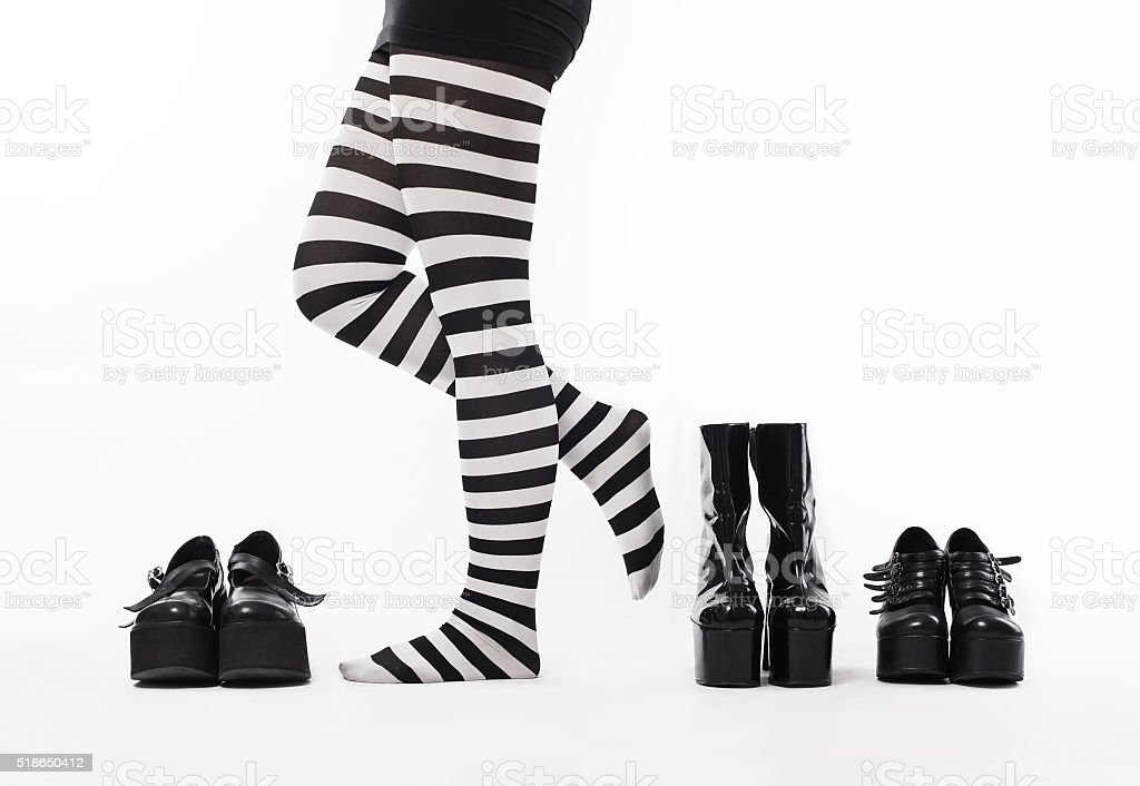 Woman with many shoes stock photo