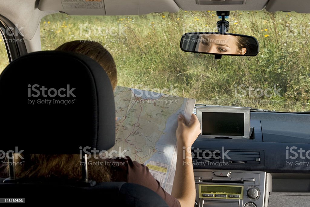 Woman with map in the car. royalty-free stock photo