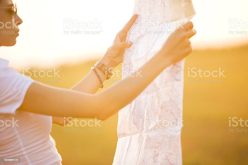 Woman with map royalty-free stock photo