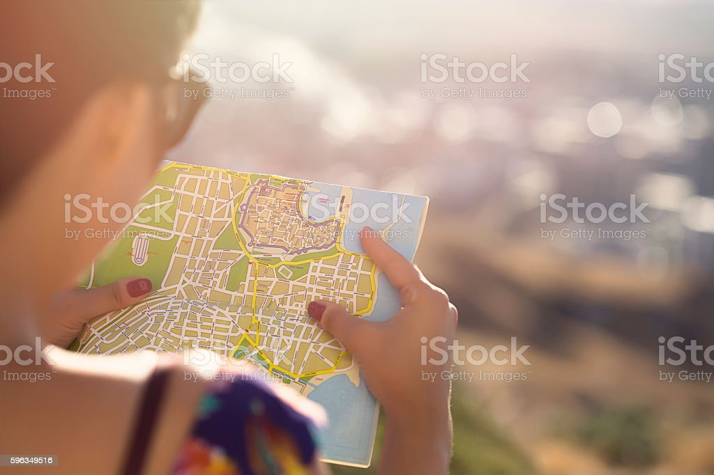 Woman with map stock photo