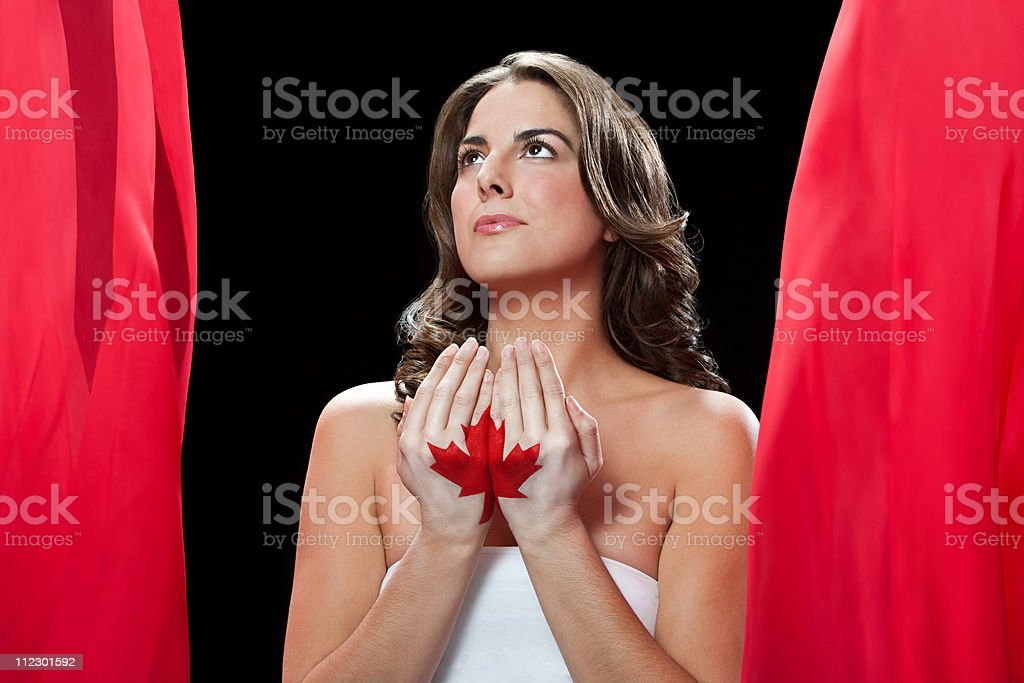 Woman with maple leaf painted on hands royalty-free stock photo