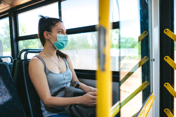 Woman with mask in bus stock photo