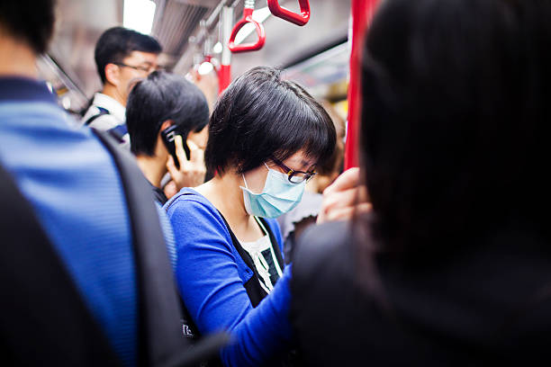 Woman with mask in subway train stock photo