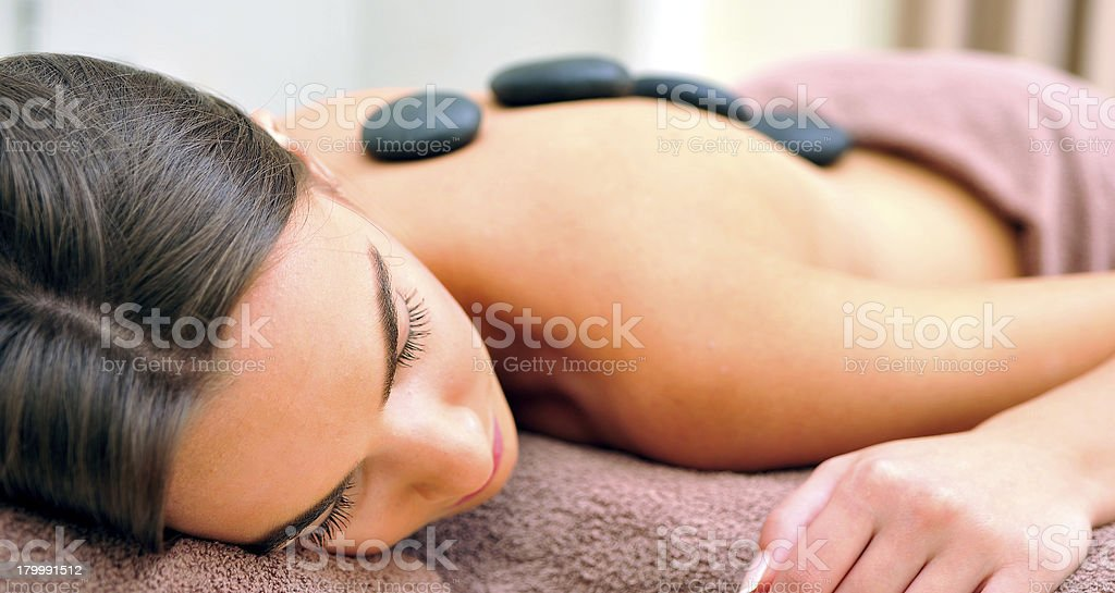 Woman with massage stones stock photo