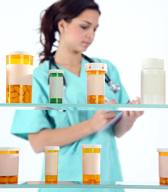 woman with meds - prescription meds stock pictures, royalty-free photos & images