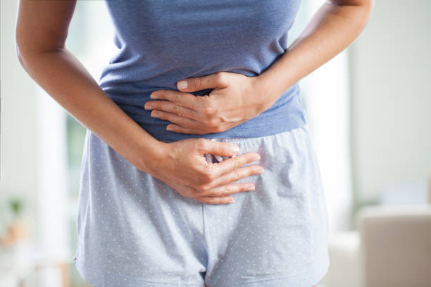Woman with menstrual pain Young woman having painful stomach ache. Chronic gastritis. Stomach or menstrual cramps. Abdomen bloating concept. uterus stock pictures, royalty-free photos & images