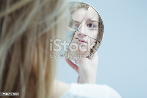 istock Woman with mental disorder 590282968