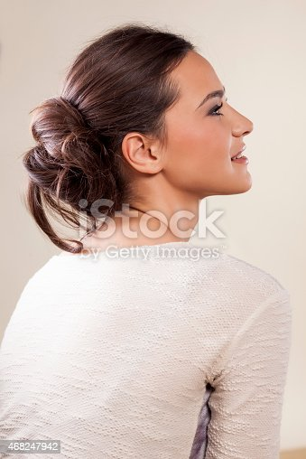 young woman with messy lower bun
