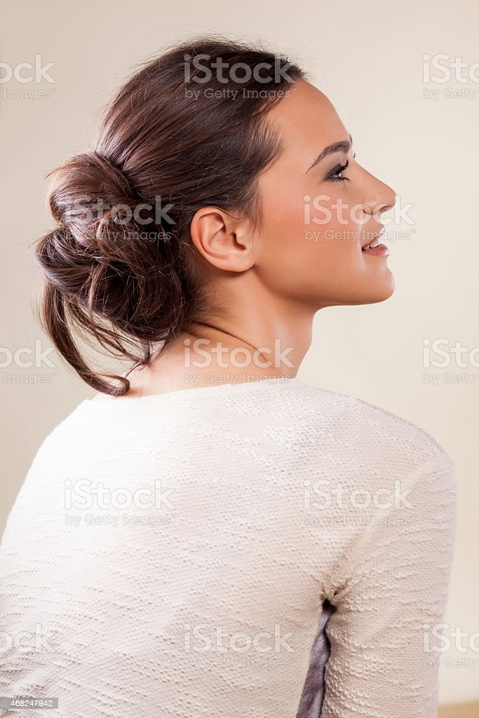 woman with messy lower bun stock photo