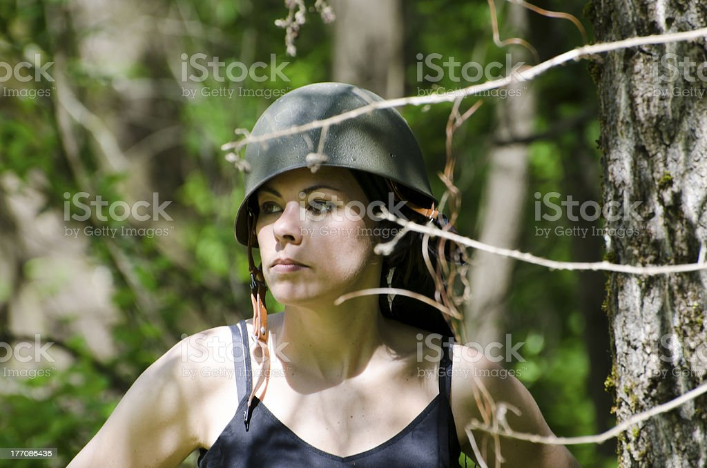 Woman with military helmet stock photo