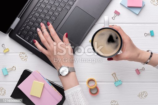 831932306 istock photo Woman with minimal pink spring summer manicure design typing on keyboard 1216566882