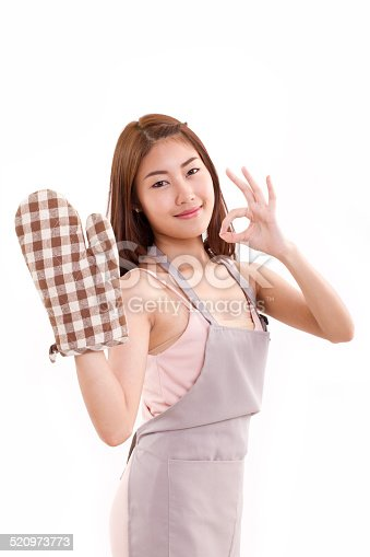 istock woman with mitten glove, showing ok hand sign 520973773