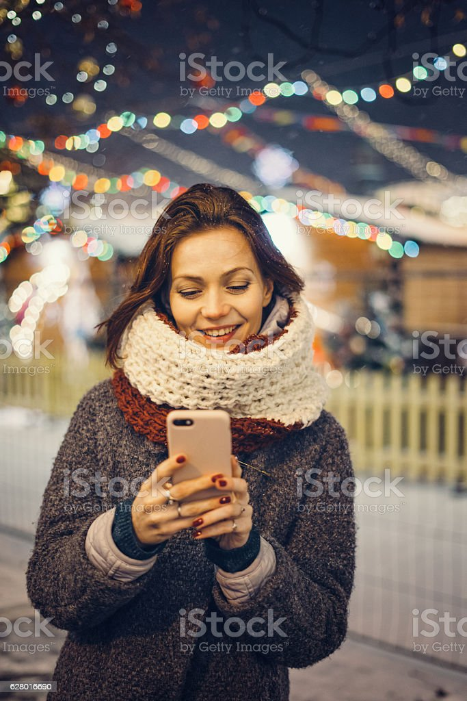 Woman with mobile phone on the street stock photo