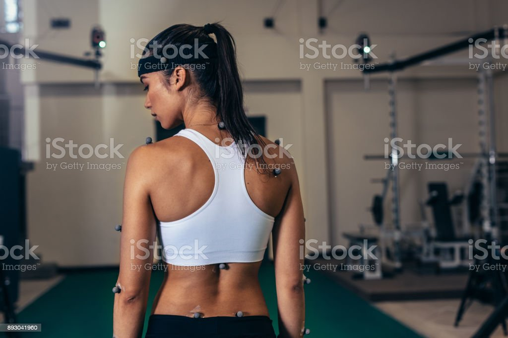 Woman with motion capture sensors at sports science lab stock photo