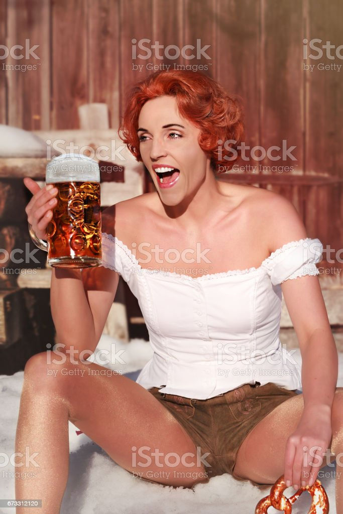 Woman with mug and pretzel stock photo