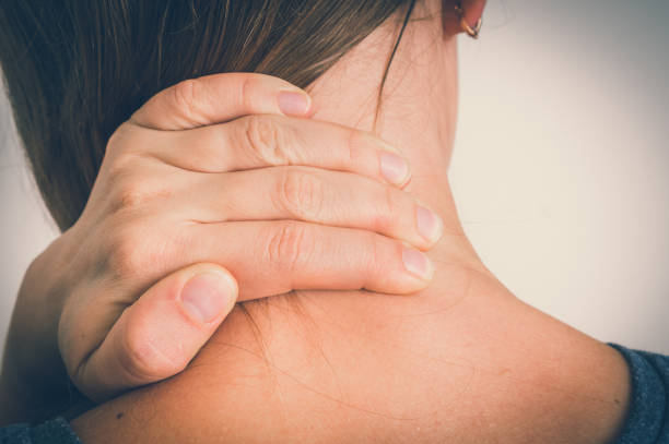 Woman with muscle injury having pain in her neck stock photo