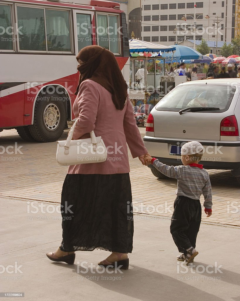 Woman with Muslim Head-scarf and young child royalty-free stock photo