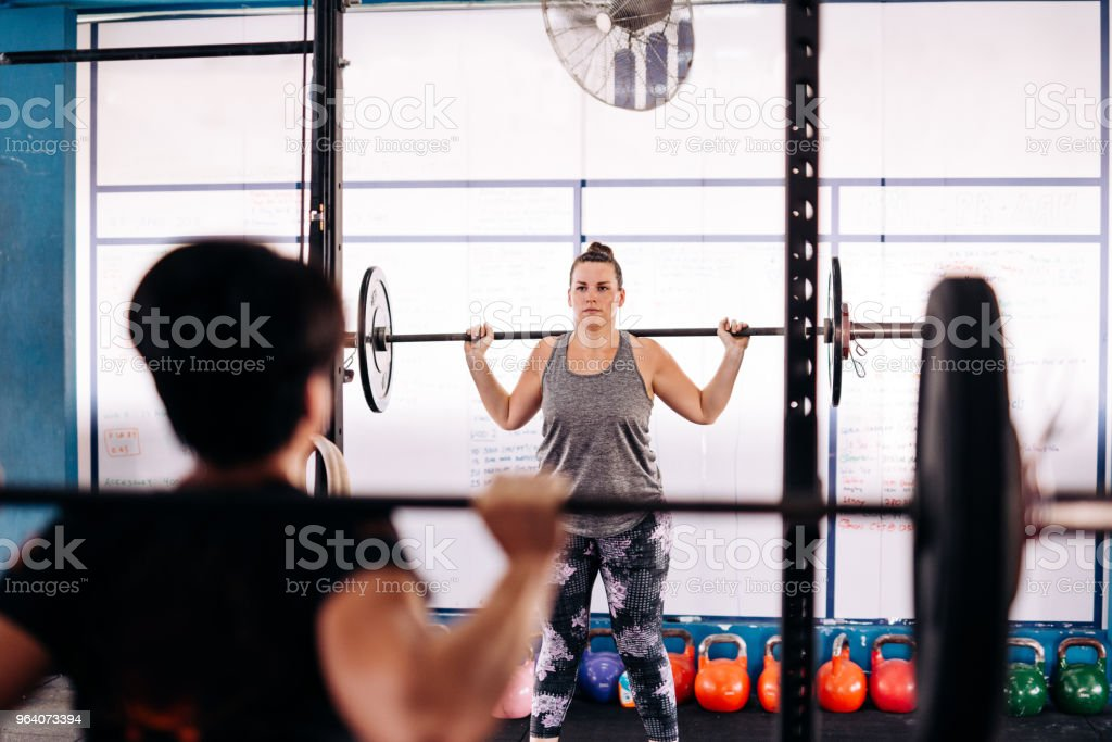 Woman with natal body on cross training - Royalty-free 20-29 Years Stock Photo
