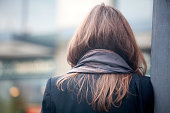 Back side of a long hair woman with neckerchief
