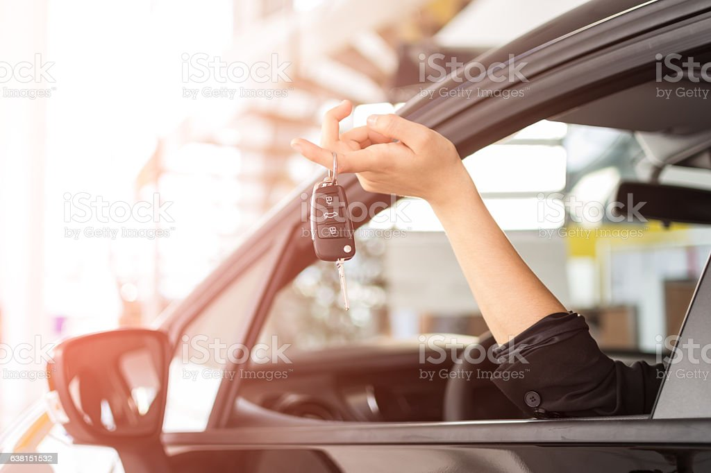 Woman with new car key stock photo
