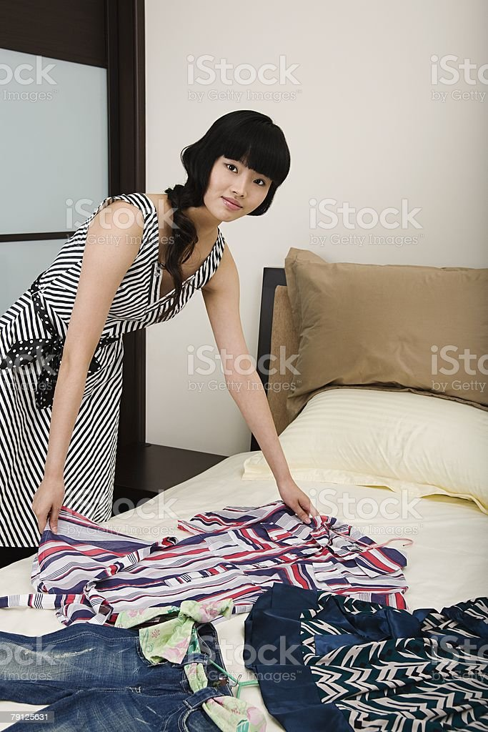 Woman with new clothes on bed royalty-free 스톡 사진