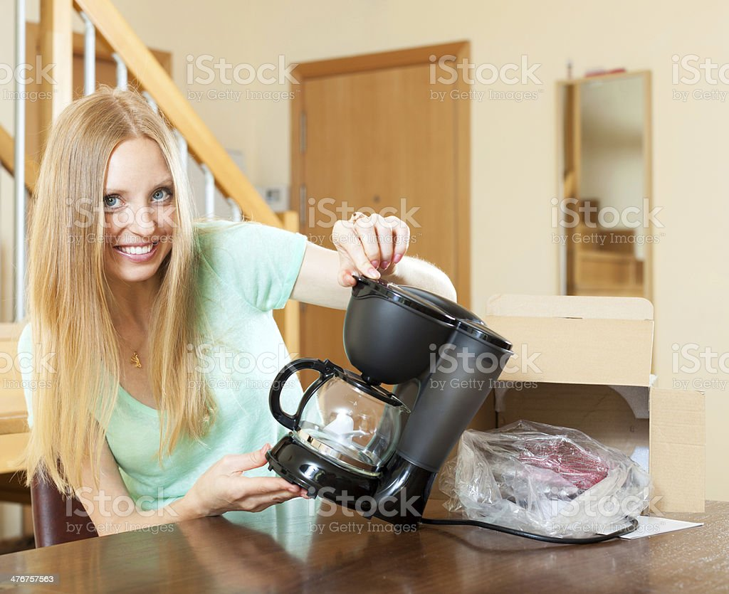 Woman with new electric coffee maker at home royalty-free stock photo