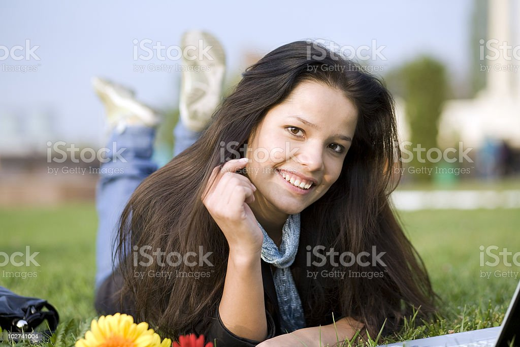 Woman with notebook at the summer park stock photo