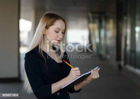 istock Woman with notebook. 959851904