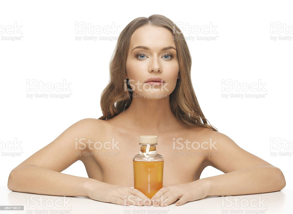 woman with oil bottle stock photo