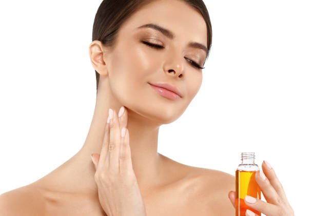 Woman with oil cosmetic beauty skin care concept. Young female model spa with oil skincare. stock photo