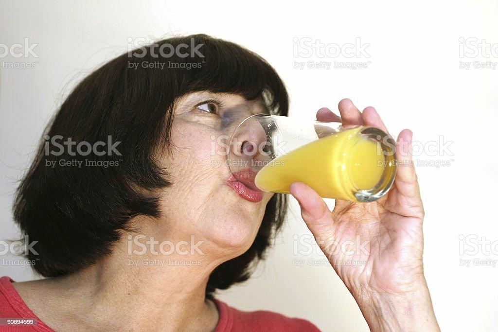 Woman with OJ royalty-free stock photo