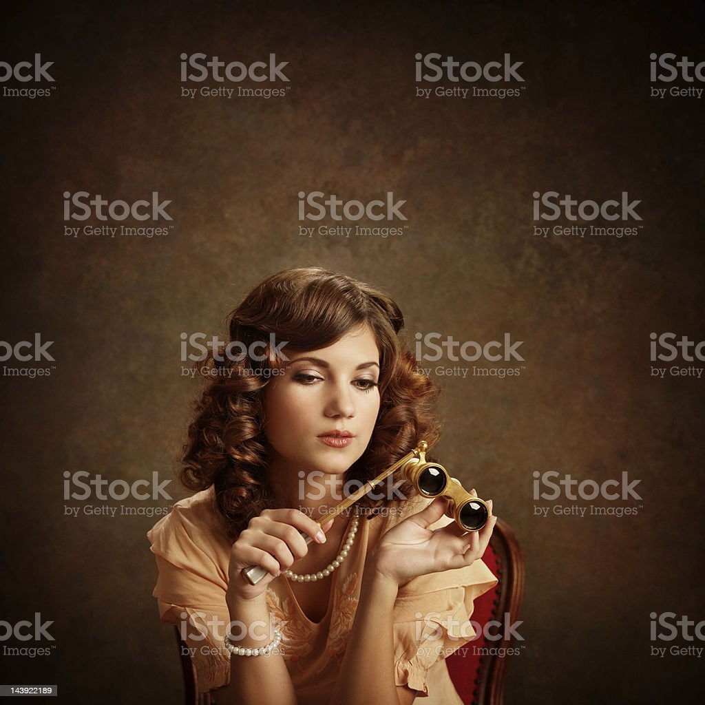 woman with opera glasses royalty-free stock photo