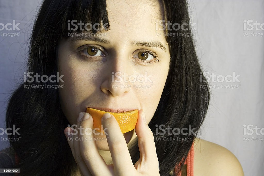 Donna con orange foto stock royalty-free
