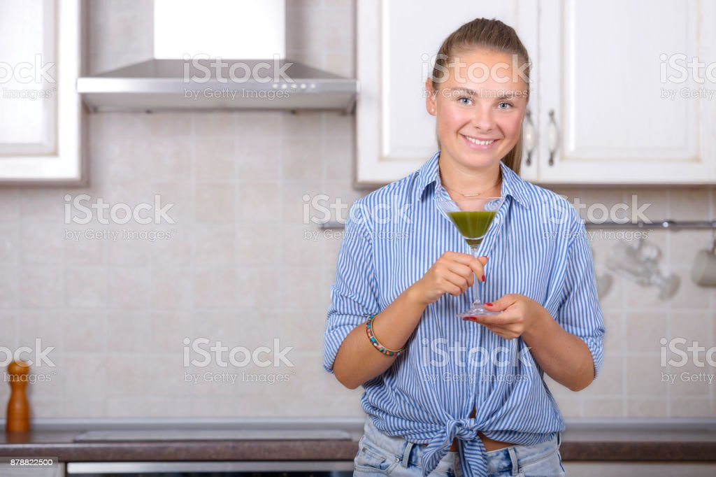 Woman with organic matcha green tea stock photo