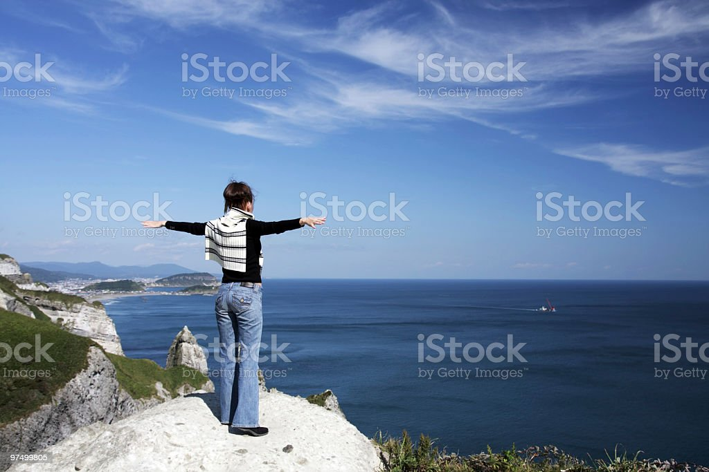Woman with outstretched arms royalty-free stock photo