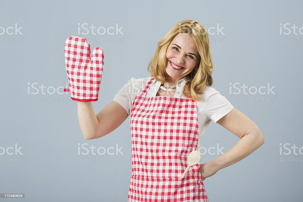 Woman with oven mitten and red apron royalty-free stock photo