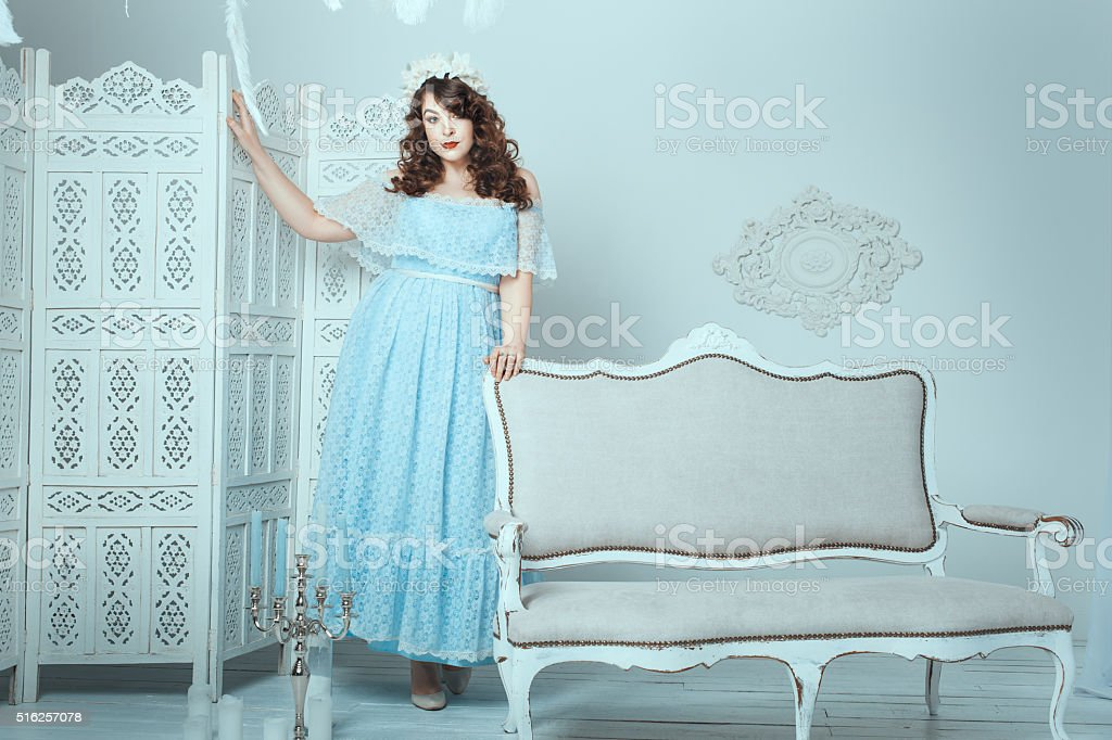 Woman with overweight standing in the room. stock photo