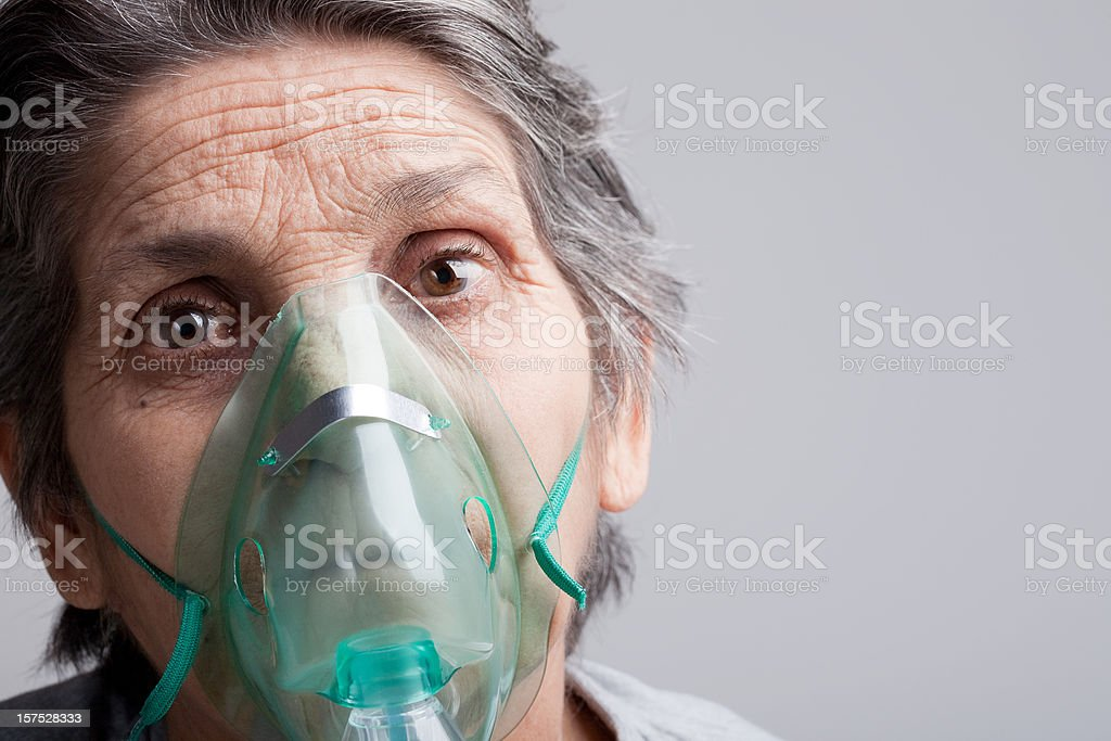 Woman with oxygen mask stock photo