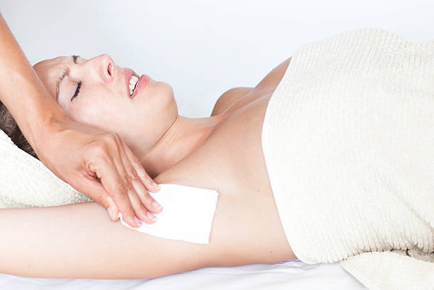 Woman with pain doing the armpit depilation stock photo