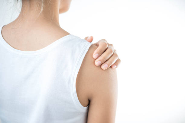 Woman with pain in shoulder. Pain in the human body,health care concept. stock photo