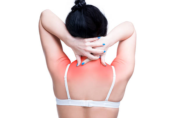 Woman with pain in shoulders and neck, isolated Young caucasian woman in bra with pain in shoulders and neck, ache in the human body, isolated on white background with red dots occipital lobe stock pictures, royalty-free photos & images