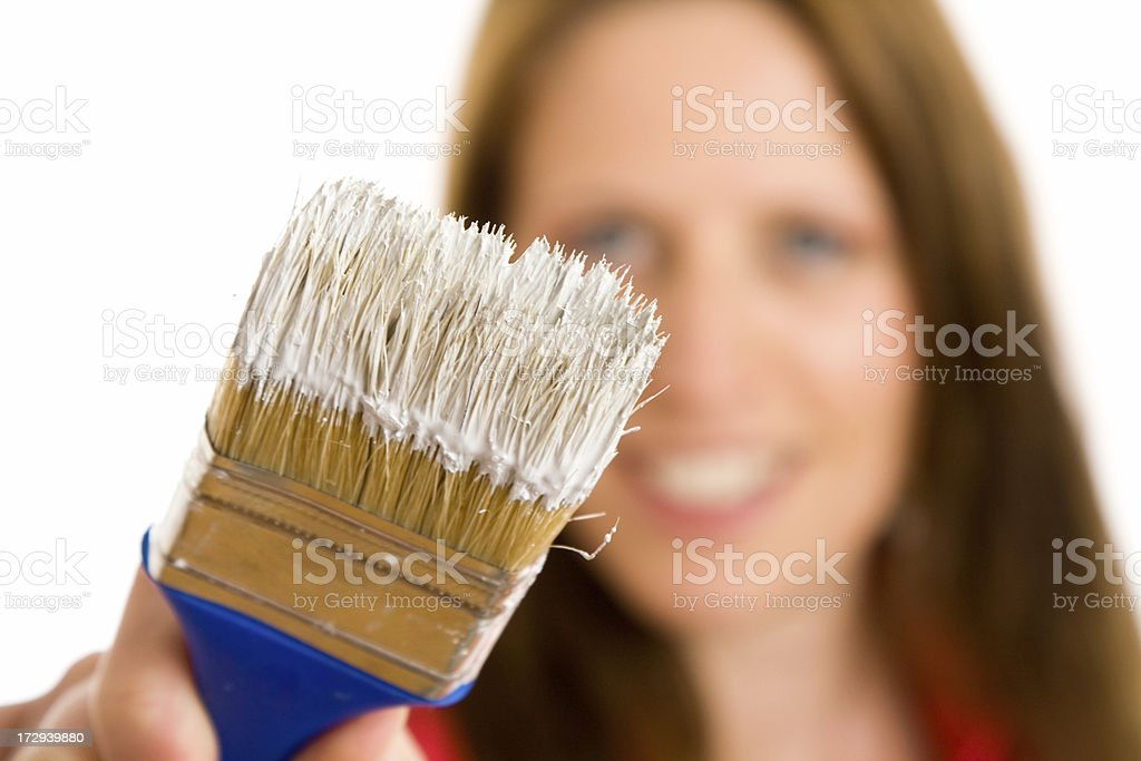 Woman with paintbrush royalty-free stock photo
