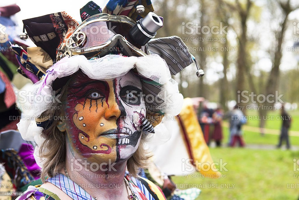 Woman with painted face wearing goggles at Fantasy Fair royalty-free stock photo