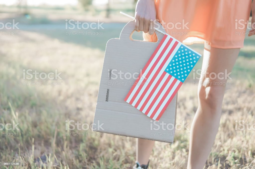 Woman with paper bag and american flag royalty-free stock photo