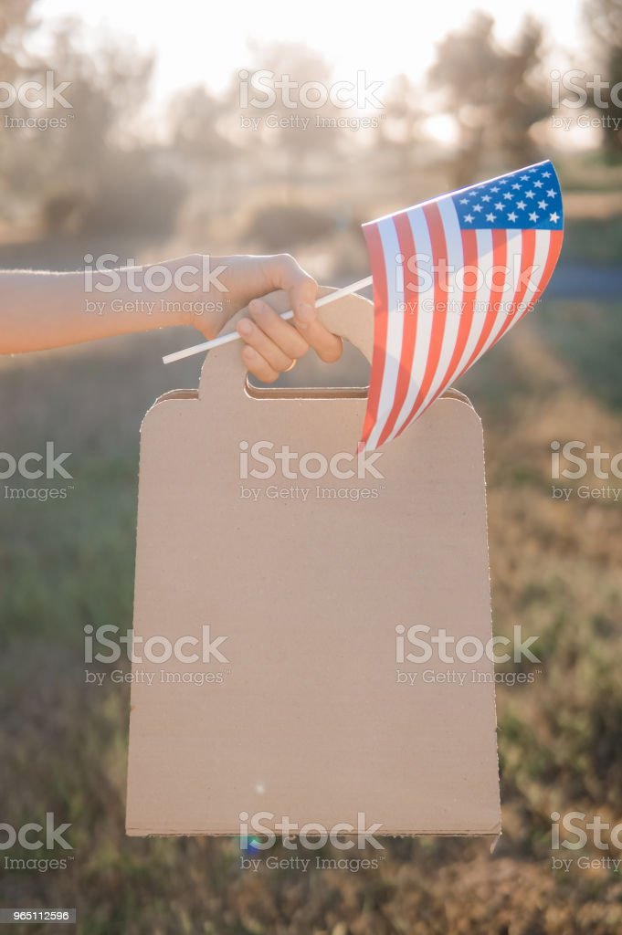 Woman with paper bag and american flag zbiór zdjęć royalty-free